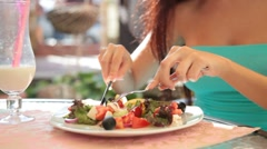 Woman eating Greek salad Stock Footage