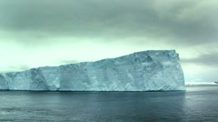 Tabular iceberg towers above the camera, antarctica Stock Footage
