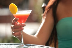 girl is holding a glass of alcoholic beverage - stock footage