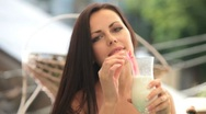 Attractive young woman with milkshake Stock Footage