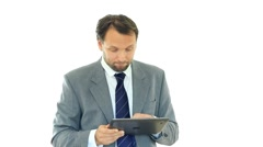 Unhappy businessman looking at bad news on tablet computer, isolated HD Stock Footage