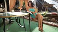 Stock Video Footage of Woman reading fashion magazine