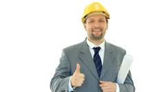 Successful engineer in yellow helmet showing ok sign, isolated on white HD Stock Footage