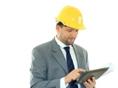 Construction engineer with tablet computer smiling, isolated on white NTSC Stock Footage