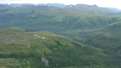 View of rocky and green mountains from helicopter (HD) c - stock footage
