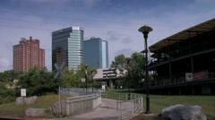 Knoxville skyline seen from Volunteer Landing Park riverwalk Stock Footage