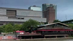 Volunteer Landing along riverwalk with Knoxville skyline in background Stock Footage