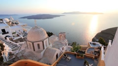 Church and the white washed houses of Thira at Sunset, Greece, Europe Stock Footage