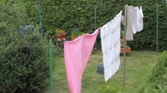 Laundry drying on a hot and windy summer day Stock Footage
