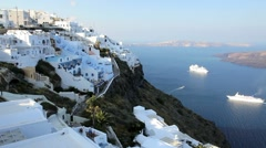 Cruise ships in the bay overlooked by the white washed houses of Thira, Greece Stock Footage