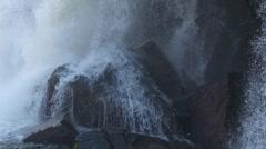 Waterfall crashing against rocks Stock Footage
