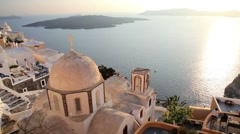 Dome of the local church and the white washed houses of Thira, Greece Stock Footage