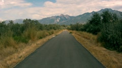 Secluded road walkway mountains and blue sky - stock footage