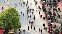 Pedestrians walking along Nanjing Road, Shanghai, China Stock Footage