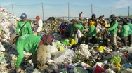People sorting through trash in a open garbage dumb or landfill Stock Footage