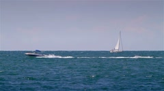 Seascape with boats passing Stock Footage