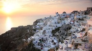 Domed white washed churches of Oia at Sunset, Santorini, Greece Stock Footage