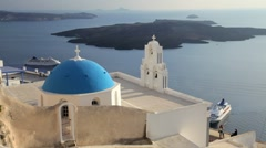 Blue Domed white washed churches of Thira, Santorini, Greece, Europe Stock Footage