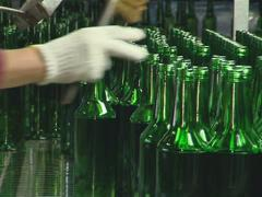Human intervention is necessary in bottle too.  Stock Footage