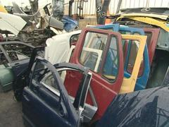 Large piles of hoods, bumpers, doors and other car parts. - stock footage