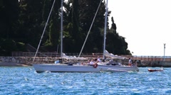 Lagoon in Croatia, small boats passing Stock Footage
