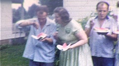 People Eating Watermelon in Backyard Picnic 1960s Vintage Film Home Movie 305 Stock Footage