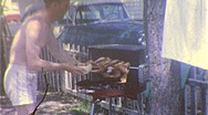 Stock Video Footage of Backyard Barbecue GRILLED CHICKEN 1960s (Vintage Film 8mm Home Movie) 306