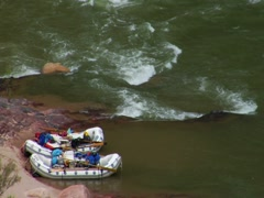 Stock Video Footage of Two Rafts Await Their Riders on the Colorado River