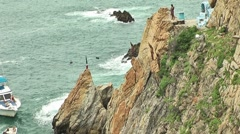 Jumping from the clift in Quebrada place, Acapulco Stock Footage