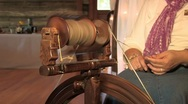 Stock Video Footage of Spinning yarn with an old spinning wheel