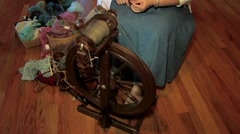 Spinning yarn with an old spinning wheel Stock Footage