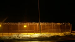 Prison yard at night Stock Footage