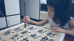 Asian kid writing Stock Footage