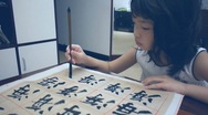 Stock Video Footage of Asian kid writing