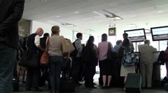 Airline passengers wait Stock Footage