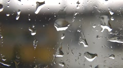Windowpane with reflexion of a rain, a fog and city street Stock Footage
