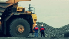 Stock Video Footage Mining Dump Truck loading excavator heavy track Stock Footage