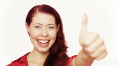 Redhead holding thumbs up Stock Footage