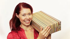 Excited woman shaking christmas gift Stock Footage