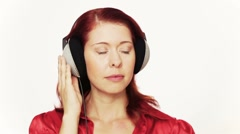 Redhead woman listening to relaxing music Stock Footage