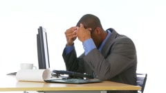 Concerned businessman with headache at desk Stock Footage