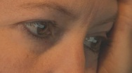 Stock Video Footage of Woman's Brown Eyes reading website - extreme close up