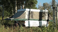 Camp trailer in mountain forest P HD 9530 Stock Footage