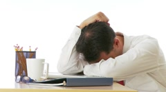 Unhappy businessman putting head on desk Stock Footage