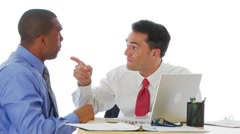 Two businessmen arguing at desk - stock footage