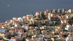 View of the traditional houses in Symi Town, Aegean Sea, Greece Stock Footage