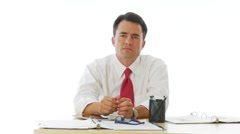 Serious businessman leaning forward at desk Stock Footage