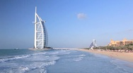 Stock Video Footage of Burj Al Arab Hotel and beachfront, Dubai, Arabian Peninsula, UAE