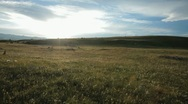Stock Video Footage of Mountain plateau. Small hill in the background. Sunset