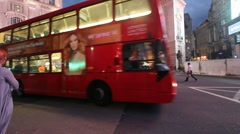 Double Deckers and pedestrians on Piccadilly Circus in London Stock Footage
